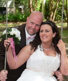 wedding photo pose of couple in a swing