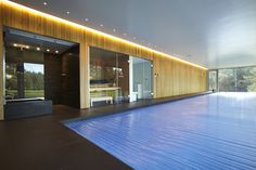 Indoor swimming pool with counter current units by Guncast