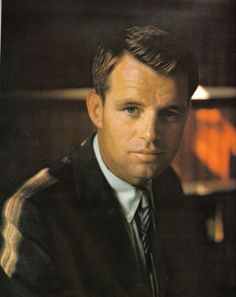 """""""All of us might wish at times that we lived in a more tranquil world, but we don't. And if our times are difficult and perplexing, so are they challenging and filled with opportunity."""" -Bobby Kennedy <3 --One of the only political figures I honestly and greatly admire. He was more than politics."""