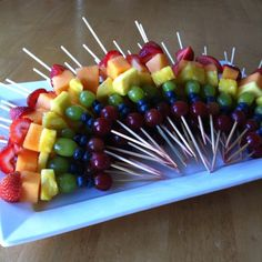 Rainbow fruit kabobs. Made these for my sister's baby shower.