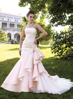 We are always looking for something unique and stylish for your wedding and events, we came across these unique and elegant Soft Pink wedding dresses which are becoming popular trend these days. Most wedding dress designers are adding soft pink touches which adds a touch elegant and sophistication to the dress. We hope you enjoy this elegant selection by Mon Cheri and Sophia Tolli.