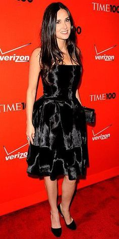 Who made Demi Moore's black dress, clutch and jewelry that she wore to Time's 100 Most Influential People in the World Gala? Dress – Loewe  Purse – Ferragamo  Jewelry – Cartier