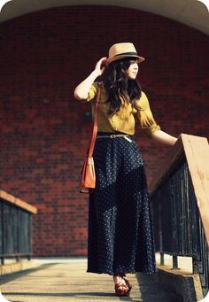 Skirt Print: Polka Dots #3. Wear a polka dot maxi skirt belted with a mustard yellow top, and fedora hat.