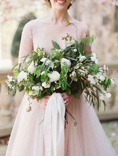 White wedding bouquet with lots of greenery. Frou Frou chic ribbon. Blush wedding gown. #weddingideas