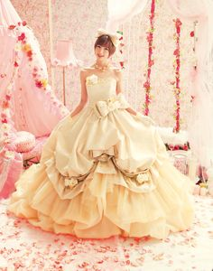 Gold Wedding Dress with lots of ribbon and flowers with a balloon skirt