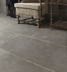 Classic Tyrone Limestone in a tumbled finish. These grey limestone flagstones from Ca' Pietra are full of character.