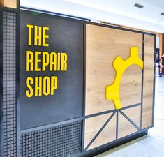 The logo of the Repair Shop Kiosk interior design by ORO Design, Sydney. #ORODesignStudio #design #style #store #trendy #interior #retail #yellow #impact #industrial #rustic #elements #wood #metal #wire #frames #bright #mobile #accessories #logo