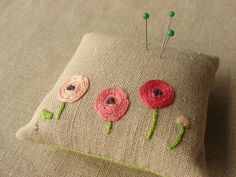 Pink Ranunculus Pincushion by barefootshepherdess, via Flickr. Could also make a sweet throw pillow in a larger size.