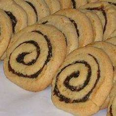 Pinwheel cookies are filled with a date-nut fillings to create a delicious treat. Desserts With Biscuits, Cookie Desserts, Sweet Desserts, Sweet Recipes, Cookie Recipes, Delicious Desserts, Dessert Recipes, Dessert Biscuits, Dishes Recipes