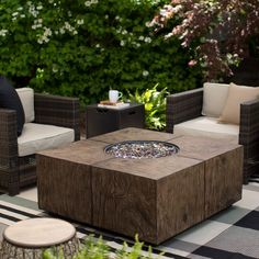 Red Ember Stockton Fire Pit - The Red Ember Stockton Fire Pit will be the focal point of your outdoor conversation space. Constructed from faux wood Envirostone, this fire pit table...