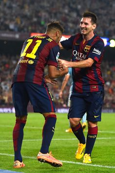 Lionel Messi of FC Barcelona celebrates with his teammate Neymar of FC Barcelona after scoring his team's third goal during the La Liga match between FC Barcelona and SD Eibar at Camp Nou on October 18, 2014 in Barcelona, Catalonia.