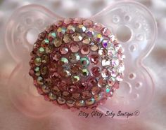 harlow had one like this when she was itty bitty. baby #2 needs one! Glitzy Girl Bling Pacifier on a MAM. $23.00, via Etsy.