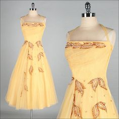 This gorgeous halter dress has a narrower strap around the neck. Definitely vintage 1950s Dress  Yellow Tulle  Gold by millstreetvintage, $245.00