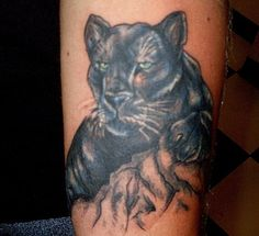 Black panther face tattoo