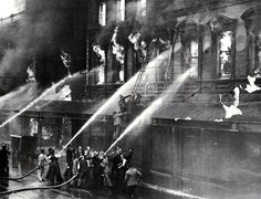 Rescuing Mr K. Ballantyne from the burning building on Colombo Street, Christchurch