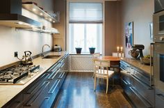 Stainless Steel kitchen with limestone floor from www.mybluechina.com