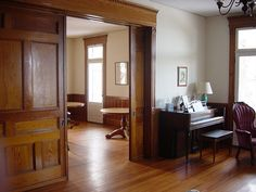 pocket doors in an old house; would love to have them if I ever built a house Little Green House, Room Doors, Pocket Doors, Foyers, Staircases, Door Design, Fixer Upper, Dream Homes, Woodwork