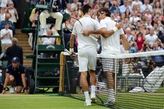 Novak Djokovic and Roger Federer congratulate eachother after their semi-final match. - Matthias Hangst/AELTC
