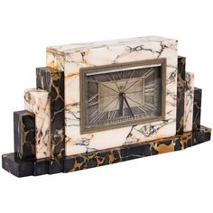 French Art Deco Marble Mantel Clock, circa 1930s   From a unique collection of antique and modern clocks at https://www.1stdibs.com/furniture/decorative-objects/clocks/