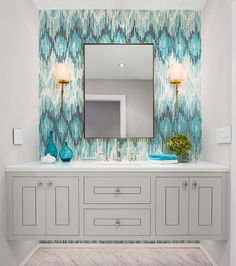 What powder room dreams are made of 💙✨ Mosaic: Loom by @sarambaldwin from the #NewRavenna Ikat collection | #interiordesign by @robertfrankinteriors . . . #ikat #textile #mosaic #mosaicwall #bathroomdesign #interiorstyling #customhome #custombath #floatingvanity #sconce #instahome #instadecor #instadesign #makehomeyours #beautifulhomes