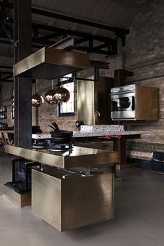 Masculine Contemporary Industrial kitchen interior with gold finishings