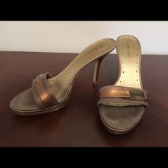 BCBG GIRLS slip on's bronze heel mules size 7.5 Beautiful bronze linen fabric and metal combination slip on mules. Elegant heel even for an evening out BCBGirls Shoes Mules & Clogs