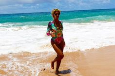 Beyonce rocked a one-piece swimsuit with Lemonade-themed accessories while on vacation! Get all the details of her trip with Jay Z!