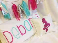 Found this awesome garland at hobby lobby and my daughter wanted a mermaid theme...couldn't find much decor to match so starting with #Diypillows #diy #pillowcover #mermaidpilllow #mermaid #pink #turquoise #pinkroom #mermaidroom #seatheme #girlroom