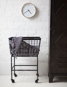 This stylish iron basket on wheels  with various uses is a perfect storage solution as can be moved around to wherever it is needed. Made of metal with four caster wheels this would be great for your laundry, or blankets, or even magazines.