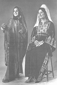 Left, a woman in Saudi Arab dress of Royal Family and Right, a woman in Palestine dress from Bethlehem