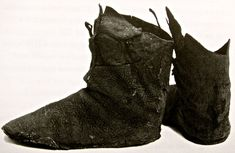 A pair of thirteenth century boots found at the bottom of the cesspit in Spital Square, London.