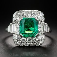 Emerald and Diamond Ring. Emerald and diamond rings rarely get more spectacular than this mid-century classic jewel. The vibrant Colombian emerald is framed with a diamond embellished platinum cushion featuring sparkling bead-set round diamonds, off-set w Art Deco Diamond Rings, Diamond Art, Art Deco Ring, Art Deco Jewelry, Fine Jewelry, Jewellery Box, Jewelry Rings, Vintage Engagement Rings, Vintage Rings
