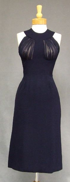 Early 1960's cocktail dress in navy blue crepe by Oleg Cassini.