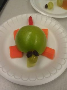 Turtle snack made from a gummy worm, grape, raisins, carrots and an apple!