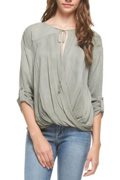 A textured blouse for either work or play the swooped front keeps it together with a tassel tie. Button tabs at the elbow make for an easy cuff. This top just need your favorite denim booties and maybe a floppy hat to head out the door!  Olive High Low Top by Lush. Clothing - Tops - Blouses & Shirts California