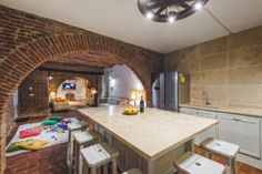 While the adults are cooking or drinking some wine in the kitchen, the children can play in the large space of the tavern.