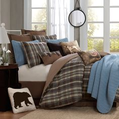 Give your room a classic look with this four-piece plaid comforter set. Featuring a rustic brown and blue pattern, this set includes a comforter, bedskirt, and two shams (one sham in twin set) allowing you to make over your space with minimal effort.