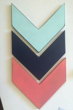 Rustic Wooden Arrow Set, Set of Three Chevron Arrows, Wood Arrow Signs, Woodland Nursery Decor, Rustic Home Decor, Rustic Nursery Decor  Mint green/Coral/Navy Blue  Each arrow measures app 10 wide (flat parallel sides) and 10 from top to bottom (tip to tip)  Hardware included  *I look forward to doing business with new customers and guarantee my work. If you are not satisfied with your purchase I will give you a full refund. Thank you!
