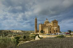 https://flic.kr/p/paH24d | Ta' Pinu Church, Gozo | There's quite a few shots I haven't got round to sorting out, whilst looking for something else I found this one from Gozo that I thought deserved an airing, shot on a great bright day, late afternoon with the Church illuminated.  The Sanctuary of Ta' Pinu is an architectural masterpiece built in an isolated site in the valley between the villages of Gharb and Ghammar. It is a shrine to Our Lady of Ta' Pinu and stands proud amongst the…