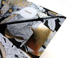 Hmmm, what print used to be - gold foil paper invitation for Mulberry Fall 2011 show. beautifully ornate illustration.