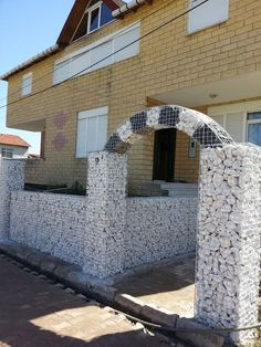 gabion fence.  I like the arch on this!