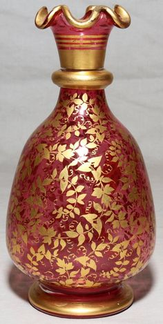 """MOSER CRANBERRY GLASS VASE, C. 1870, H 6 1/3"""":Ruffled gilt edge. Not signed. From the collection of Mural Charon, author of """"Moser, King of Glass""""."""