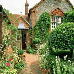 Country front garden with brick paving and pots | Front garden design ideas | Garden | PHOTO GALLERY | Country Homes and Interiors | Housetohome.co.uk