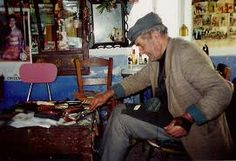 Local shoemaker making boots in Olympos Karpathos