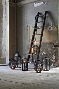 lanterns clustered around old ladder Vintage Ladder, Blog Logo, Interior Decorating, Interior Design, Candle Lanterns, Home And Deco, Home Living, Industrial Chic, Ladder Decor