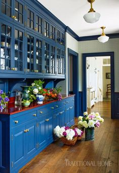 royal blue cabinetry with red counter top make a personal statement in this traditional home. Tanna Espy, DesignNashville
