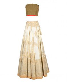 Beige lengha with block printed paisley motifs all over. Thread stitching accents at the hem with dark beige borders. Wash Care: Dry clean onlyBrown stitched blouse piece with beads embellishmentsMatching dupatta included