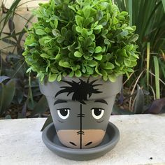 Items similar to Eeyore Inspired Hand-painted Flower Pot on Etsy Flower Pot Art, Flower Pot Design, Clay Flower Pots, Flower Pot Crafts, Clay Pots, Cactus Flower, Clay Pot Projects, Clay Pot Crafts, Painted Plant Pots