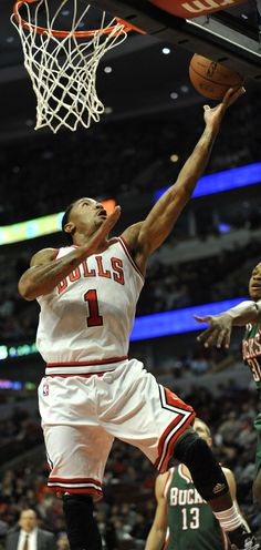 Chicago Bulls' Derrick Rose (1), goes up for a shot against the Milwaukee Bucks during the first half of an NBA preseason basketball game in Chicago, Monday, Oct. 21, 2013. (AP Photo/Paul Beaty)