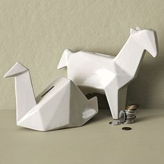 the origami crane form for a teapot---head=the spout, its back=lid